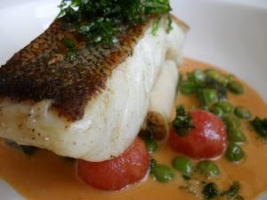 Salted Cod loin, roasted tomato veloute, seafood cannelloni, samphire, peas, crispy sea lettuce